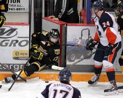 Brandon's John Quenneville takes a stick in the nose from Kamloops' Ryan Rehill Tuesday at Westman Place.