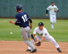 Brandon Cloverleafs infielder Jason Shaul eyes up a grounder as Reston Rockets base-runner Cody Bertholet advances at Andrews Field on Tuesday night. The Cloverleafs beat the defending MSBL champion Rockets 9-5.