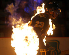 Brandon Wheat Kings forward Tim McGauley skates into Westman Place through balls of flame during the season-opening matchup on Friday night. The Wheat Kings kicked off the 2012-13 Western Hockey League season by defeating the Regina Pats 3-2.