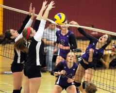 Crocus Plains' Emma Donnelly (left) and Mackenzie Pearson try to block Vincent Massey's Kelli Fraser Tuesday.