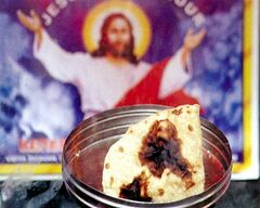 A chapatti with an image resembling Jesus Christ on display at Renewal Retreat Center in Bangalore, India, Nov. 16, 2002.THE CANADIAN PRESS/AP, Press Trust of India