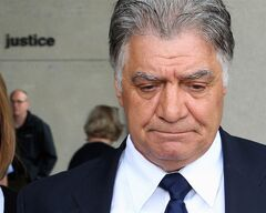 London Mayor Joe Fontana walks from the London, Ont., courthouse after hearing the verdict in his fraud trial Friday, June 13, 2014. Fontana, who was convicted last week on three fraud-related charges from his time as a federal Liberal cabinet minister, is stepping down.THE CANADIAN PRESS/Dave Chidley