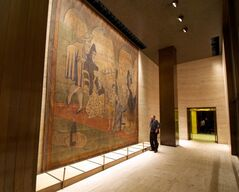 FILE- In this Feb. 28, 2014, file photo provided by the New York Landmarks Conservancy, a stage curtain painted by Pablo Picasso hangs on a wall at the Four Seasons restaurant in New York. The 19-by-20-foot curtain, called