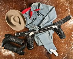 This photo provided by A & S Auction Company of Waco, Texas shows the outfit Lone Ranger actor Clayton Moore wore when he made appearances as the character after retiring from television. A & S Auction Co. will offer up the items for auction on Saturday, July 12, 2014. Moore, who died in 1999, played the masked lawman on the ABC television series
