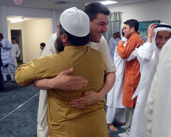 Bashir Bashir greets fellow Muslims after prayers.