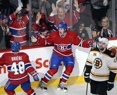 Montreal Canadiens right wing Dale Weise, centre, celebrates his goal with Montreal Canadiens center Daniel Briere, left, as Boston Bruins defenceman Andrej Meszaros (41) looks on during second period NHL playoff hockey action in Montreal on May 6, 2014. Even tough he grew up in Winnipeg, Dale Weise has always been a Montreal Canadiens fan. So he was thrilled when the Canadiens made a trade with the Vancouver Canucks to get him during the season. And now he's making the most of it with some timely goals in the playoffs, including the game-winner in Game 3 against the Boston Bruins that gave Montreal a 2-1 series lead. THE CANADIAN PRESS/Ryan Remiorz