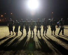 The Neelin Spartans football team practises under floodlights at the school's field in October 2012.