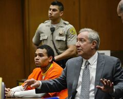 R&B singer Chris Brown appears in court with his attorney Mark Geragos, right, on Thursday, May 1, 2014, in Los Angeles. Superior Court Judge James Brandlin ordered Brown to appear in court again next week to update him on efforts between the singer's attorney and prosecutors to strike a deal on probation issues in the singer's 2009 assault case filed after his attack on then-girlfriend Rihanna. (AP Photo/Kevork Djansezian, Pool)