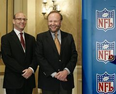 FILE - In this May 25, 2005 file photo, Tampa Bay Buccaneers team owner and president Malcolm Glazer, right, joined by Joel Glazer, left, are all smiles as they gather for the announcement of Tampa Bay being awarded the 2009 Super Bowl, during the NFL's Spring Meetings at the Ritz-Carlton Hotel in Washington. Glazer, the self-made billionaire who owned the NFL's Tampa Bay Buccaneers and English soccer's Manchester United, has died. He was 85. The Bucs said Glazer died Wednesday, May 28, 2014. (AP Photo/J. Scott Applewhite, File)