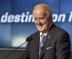 Former Canadian prime minister and Quebecor vice-chairman Brian Mulroney at a news conference outlining TVA's NHL coverage plans this season in Boucherville, Que., Wednesday, Sept.3, 2014. THE CANADIAN PRESS/Paul Chiasson