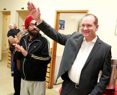 Rolf Dinsdale waves to the crowd after winning the Liberal nomination for Brandon-Souris on Wednesday evening.