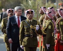 Prime Minister Stephen Harper inspects an honour guard as he meets with the Prime Minister of Jordan Abdullah Ensour in Amman, Jordan on Thursday, January 23, 2014. While in the Middle East Harper is visiting Israel, the West Bank, and Jordan. THE CANADIAN PRESS/Sean Kilpatrick