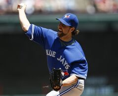 Toronto Blue Jays starting pitcher R.A. Dickey delivers a pitch to the Texas Rangers during the first inning of a baseball game, Sunday, May 18, 2014, in Arlington, Texas. (AP Photo/Jim Cowsert)