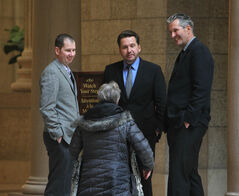A passerby congratulates newly elected Shannon Martin, left, and Doyle Piwniuk, centre, at the legislature this morning. They were immediately given shadow cabinet jobs by Tory Leader Brian Pallister.