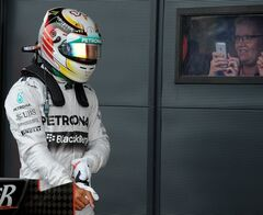 Britain's Lewis Hamilton of Mercedes leaves the pits after qualifying in sixth place forSunday's British Formula One Grand Prix at Silverstone circuit, Silverstone, England, Saturday, July 5, 2014. The British Formula One Grand Prix will be held on Sunday, July 6, 2014. (AP Photo/Rui Vieira)