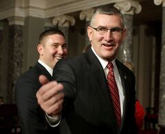 FILE - In this Feb. 11, 2014, file photo, Sen. John Walsh, D-Mont., right, and his son Michael leave the Old Senate Chamber on Capitol Hill in Washington, after a ceremonial swearing-in ceremony with Vice President Joe Biden. Walsh's thesis written for the U.S. Army War College contains unattributed passages that appear to be taken word-for-word from previously published papers. The Democrat is running to keep the seat he was appointed to in February. Walsh faces Republican U.S. Rep. Steve Daines on Nov. 4. (AP Photo/Lauren Victoria Burke, File)