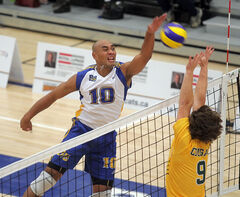 New Zealand import Sam Tuivai of the Bobcats hammers a ball at a Regina Cougars defender in Canada West action on Oct. 26.