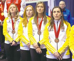 Chelsea Carey (from left) and teammates Kristy McDonald, Kristen Foster and Lindsay Titheridge receive their medals.