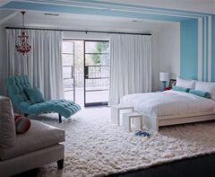 In this photo provided by Burnham Design, designer Betsy Burnham filled this bedroom for a preteen girl with white bedding, a white rug and chair, and white curtains, then added just one piece of furniture, a bit of paint and a few accessories in the girl's current favorite color. The room can easily (and affordably) take on a new look if her taste in colors changes as she grows. (AP Photo/Burnham Design, Grey Crawford)