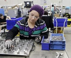 In this April 15, 2014 photo, Evelyn Morales assembles blender blades at the Vitamix manufacturing facility in Strongsville, Ohio. U.S. economic growth should accelerate in the second quarter and remain healthy for the rest of this year, according to a forecast Monday, June 9, 2014 by a group of U.S. business economists. Still, growth for the full year will likely come in lower than they previously estimated. (AP Photo/Mark Duncan)