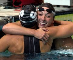 FILE - In this Aug. 16, 2000 file photo, Amy Van Dyken, right, of Lone Tree, Colo., hugs Dara Torres of Palo Alto, Calif., after Torres won the finals of the women's 50-meter freestyle at the U.S. Olympic Swimming Trials in Indianapolis. Six-time Olympic gold medalist Van Dyken has a severed spine after an accident on her all-terrain vehicle in Arizona. A hospital spokeswoman didn't provide details Monday on the injuries. The swimmer was hurt Friday night, June 6, 2014, and told emergency workers at the scene she could not move her toes or feel anything touching her legs. (AP Photo/Chris O'Meara, File)