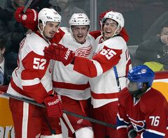 Detroit Red Wings center Gustav Nyquist (14) celebrates his winning goal with teammates defenseman Jonathan Ericsson (52) and defenseman Danny DeKeyser (65) as Montreal Canadiens defenseman P.K. Subban (76) skates by during overtime National Hockey League action Wednesday, February 26, 2014 in Montreal.THE CANADIAN PRESS/Ryan Remiorz