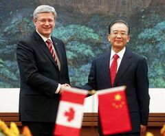 Canadian Prime Minister Stephen Harper, left, shakes hands with Chinese Premier Wen Jiabao at the end of a signing ceremony held at the Great Hall of the People in Beijing Wednesday, Feb. 8, 2012. Harper will make a cameo appearance on a big international political stage Tuesday night - although it's hardly one he would have chosen. THE CANADIAN PRESS/AP/Diego Azubel