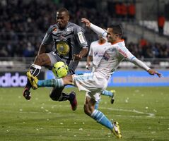 Marseille's French defender Jeremy Morel, right, challenges for the ball with Ajaccio's French defender Ronald Zubar during their League One soccer match, in Marseille, southern France, Friday, March 15, 2013. (AP Photo/Claude Paris)