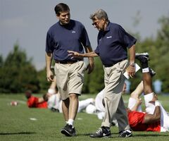 FILE - This Aug. 8, 2008 file photo shows Penn State football coach Joe Paterno, right, walking with his son and quarterback coach Jay Paterno as players stretch out during practice in State College, Pa. Jay Paterno is the author of the book,
