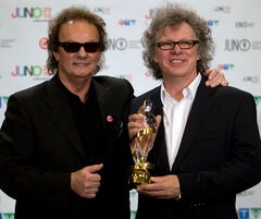 In this April 2010 photo, April Wine's Myles Goodyn, left, and Brian Greenway are seen following the band's induction into the Canadian Music Hall of Fame at the Juno awards in St. John's, N.L. The group will perform at Rock the Block next month.