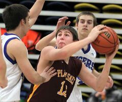Crocus Plains' Steven Fawcett looks for an opening against Swan Valley's Eric Klein (left) and Ryley Rivett Friday.
