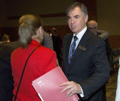 Canadian Pacific Rail board member Jim Prentice, centre, leaves the company's annual meeting in Calgary, May 1, 2014.THE CANADIAN PRESS/Jeff McIntosh