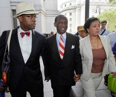 FILE - In this July 26, 2012, file photo, attorney Anthony Ricco, left, walks with Larry Seabrook, center, a New York City councilman and Seabrook's wife Maria Diaz, as they leave Federal Court in New York during Seabrook's corruption trial. It can be an uncomfortable life for any defense attorney representing unpopular clients, but when Ricco was among a handful of respected defense lawyers summoned to the federal courthouse in Manhattan after Sept. 11, he recalled his mother telling him, in a moment of outrage,