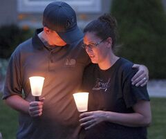 Steve and Cyndi Ford, who were friends of the Haskell family gather for a candlelight vigil, Thursday, July 10, 2014, in Logan, Utah. Ronald Lee Haskell and his family lived in Logan for several years. (AP Photo/The Herald Journal, Eli Lucero)