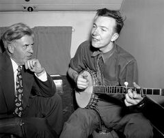 FILE - In this Aug. 28, 1948 file photo, Henry A. Wallace, Progressive Party presidential candidate, listens to Pete Seeger on a plane between Norfolk and Richmond, Va. Seeger died on Monday Jan. 27, 2014, at the age of 94. (AP Photo/File)