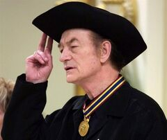 Stompin' Tom Connors holds his hat during the singing of O'Canada following the presentation of the Governor General's Performing Arts Awards during a ceremony at Rideau Hall in Ottawa, Nov. 3, 2000. THE CANADIAN PRESS/Jonathan Hayward