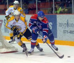 Brandon Wheat Kings Tim McGauley chases after Regina Pats Morgan Klimchuk during Saturday night's WHL game at Westman Place.