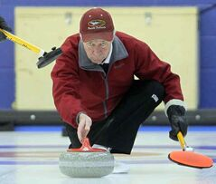 Sandy Ritchie makes a shot during the Masters' Super League curling final, Thursday afternoon at the Brandon Curling Club.