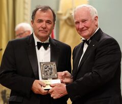 Toronto Star editor Michael Cooke poses for photograph with Governor General David Johnston after the Toronto Star won the Michener Award for Journalism at a ceremony at Rideau Hall, the official residence of the Governor General, in Ottawa, Wednesday June 11, 2014. THE CANADIAN PRESS/Fred Chartrand