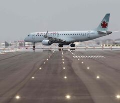 An Air Canada jet arrived on runway 13/31 and travels through the intersection of the newly resurfaced 18/36 runway.