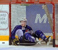 Brandon Wheat Kings left-winger Nick Buonassisi takes a spill and winds up in the net during practice Thursday at Westman Place. The Western Hockey League team's forwards have been unable to find the net in the past three games.