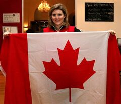 Women's ice hockey player Hayley Wickenheiser poses for a photo in St. Poelten, Austria, Thursday, Jan. 23, 2014. Hayley Wickenheiser will be Canada's Flag-Bearer at the Opening Ceremony of the Sochi 2014 Olympic Winter Games. (AP Photo/Ronald Zak) EDS NOTE: Recropped and repeat for better toning.