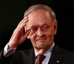 Former Prime Minister Jean Chretien waves in Ottawa, April 14, 2013. THE CANADIAN PRESS/Fred Chartrand