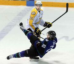 Brandon's Geordie Maguire levels Swift Current's Denis Bosc at mid-ice Wednesday night at Westman Place.