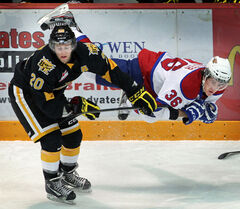 Brandon Wheat King Chad Robinson upends Edmonton Oil King Mitchell Walter this season Westman Place.