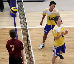 BVC's Liam Nohr celebrates a point against 204 as teammate William Ramsey looks on during the 13/14U final on Sunday.