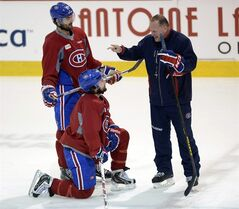 Montreal Canadiens assistant coach Gerard Gallant, right, speaks with Montreal Canadiens left wing Max Pacioretty, top, and center David Desharnais during the team's practice on May 7, 2014 in Brossard, Que. Calling it gut-check time, Montreal sniper Max Pacioretty says he has to be better against the Bruins. The winger acknowledged he has been outplayed by Bruins defenceman Zdeno Chara while failing to find the net in the first four games of their second-round playoff series. THE CANADIAN PRESS/Ryan Remiorz