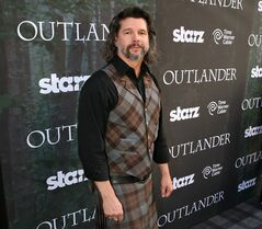 FILE - This July 25, 2014 file photo released by Starz shows executive producer Ronald D. Moore arriving at the premiere for the Starz original series