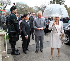 Prince Charles and his wife, the Duchess of Cornwall, are greeted by Lt.-Gov. Philip Lee at Government House on Tuesday.