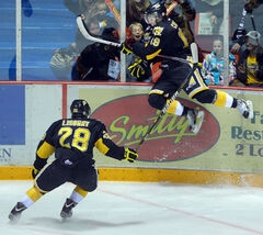 Brandon Wheat Kings forward Taylor Cooper leaps into the boards after scoring his first WHL goal on Friday night at Westman Place.